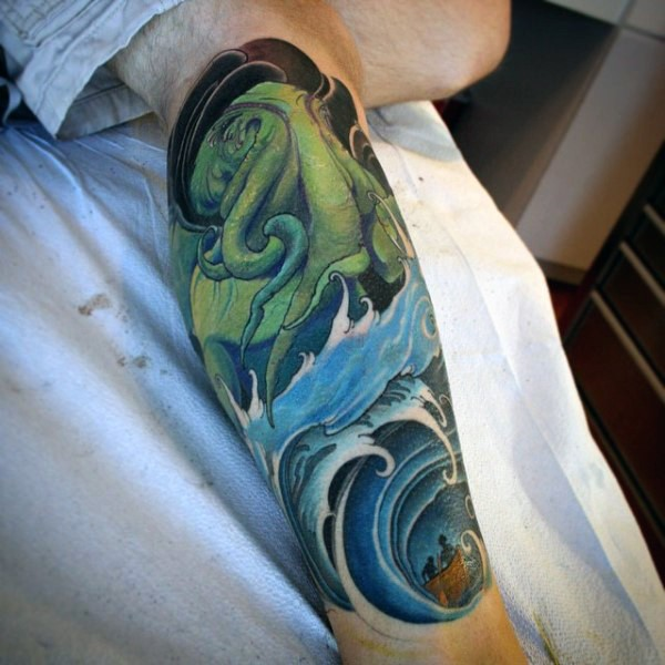 Illustrative style colored leg tattoo of green octopus with waves