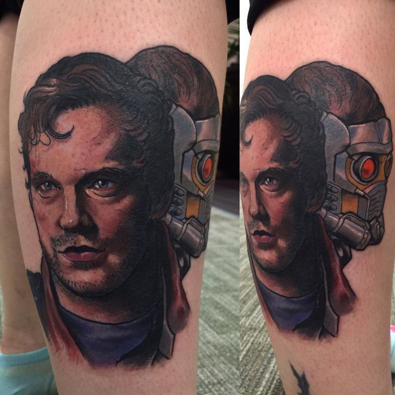 Illustrative style colored leg tattoo of movie hero