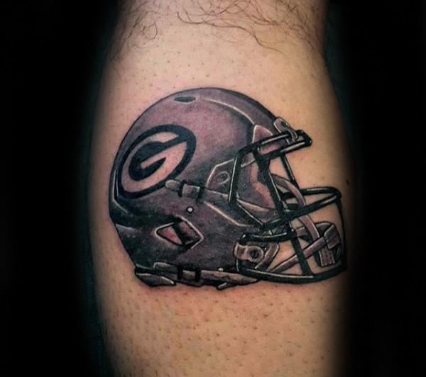 Illustrative style colored leg tattoo of American football helmet