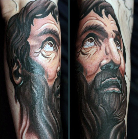 Illustrative style colored religious man portrait tattoo on forearm