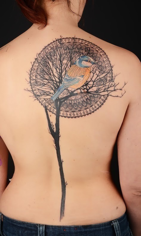 Illustrative style colored scapular tattoo of big tree with bird and ornament