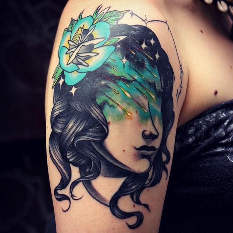 Illustrative style colored shoulder tattoo of woman with flower