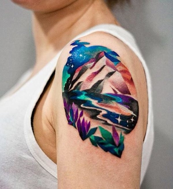 Illustrative style colored shoulder tattoo of mountains with flowers