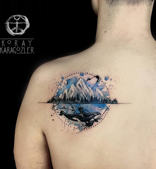 Illustrative style colored shoulder tattoo of mountains with big whale