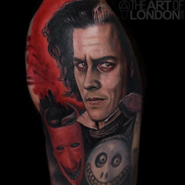 Illustrative style colored shoulder tattoo of man portrait with masks
