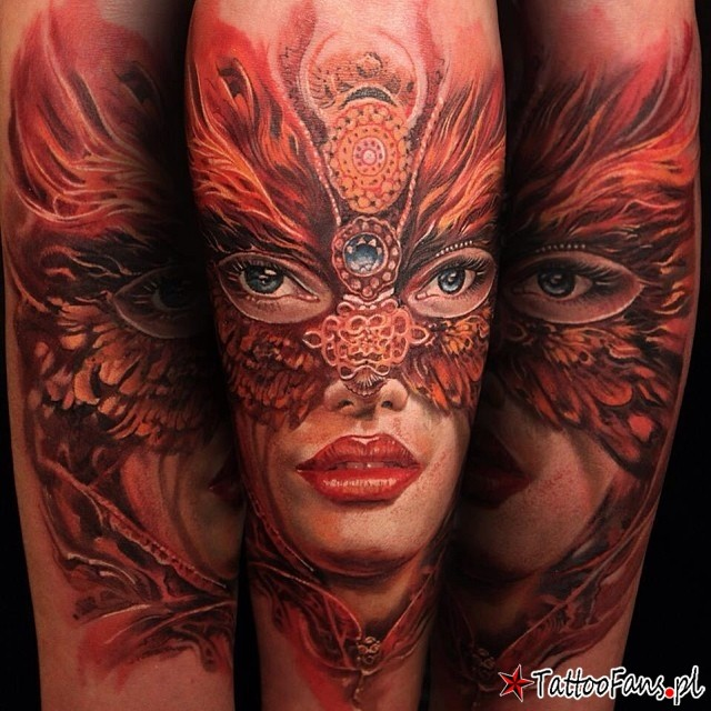 Illustrative style colored shoulder tattoo of woman portrait with butterfly like mask
