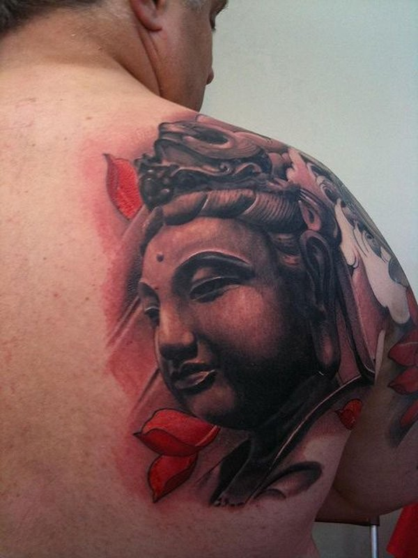 Illustrative style colored shoulder tattoo of large Buddha statue