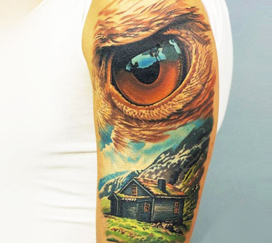 Illustrative style colored shoulder tattoo of mountain house with eagle eye