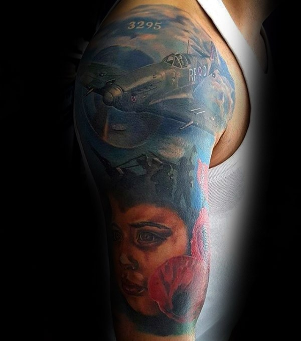 Illustrative style colored shoulder tattoo of WW2 plane with cild portrait