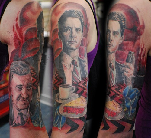 Illustrative style colored shoulder tattoo of real movie scene