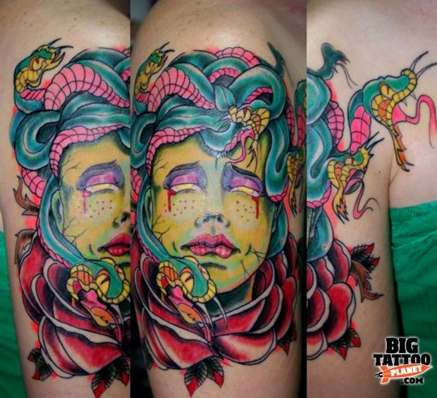 Illustrative style colored shoulder tattoo of Medusa head with rose