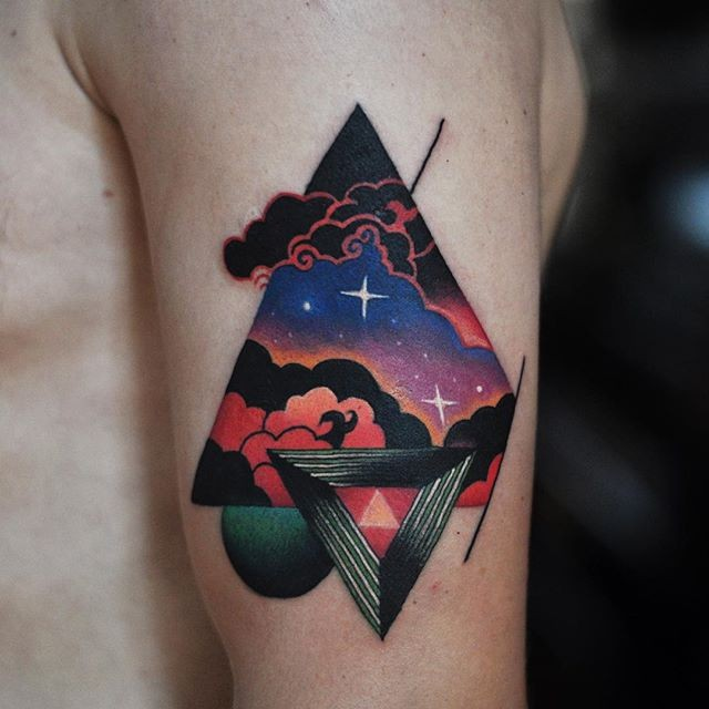 Illustrative style colored shoulder tattoo of triangle and symbol
