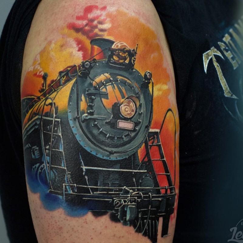 Illustrative style colored shoulder tattoo of steamy train