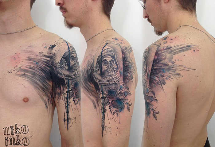 Illustrative style colored shoulder tattoo of space man skeleton