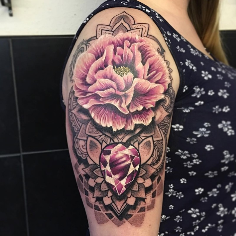 Illustrative style colored shoulder tattoo of big flowers with various ornaments
