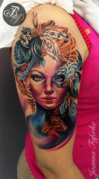 Illustrative style colored shoulder tattoo of woman with mask and flowers