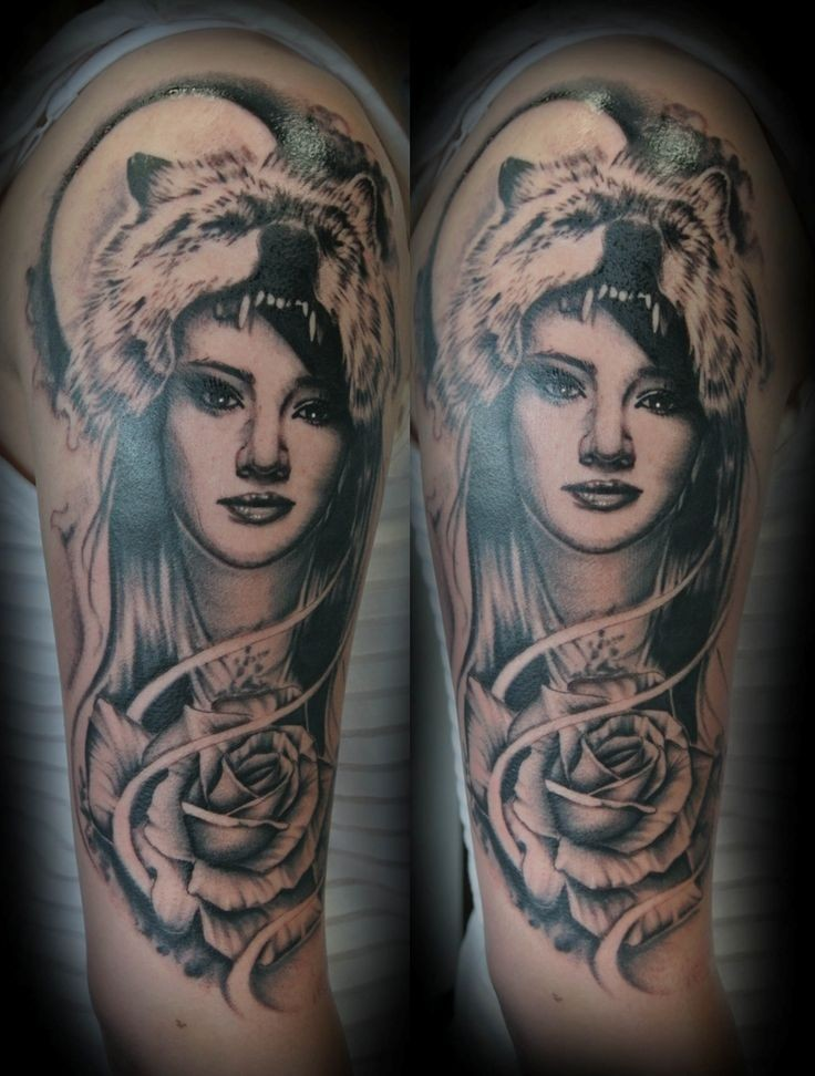 Illustrative style colored shoulder tattoo of woman face with wolf skin and rose