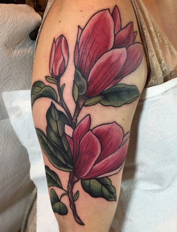 Illustrative style colored shoulder tattoo of big pink flower with leaves