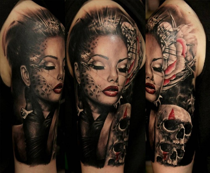 Illustrative style colored shoulder tattoo of fantasy woman with skulls