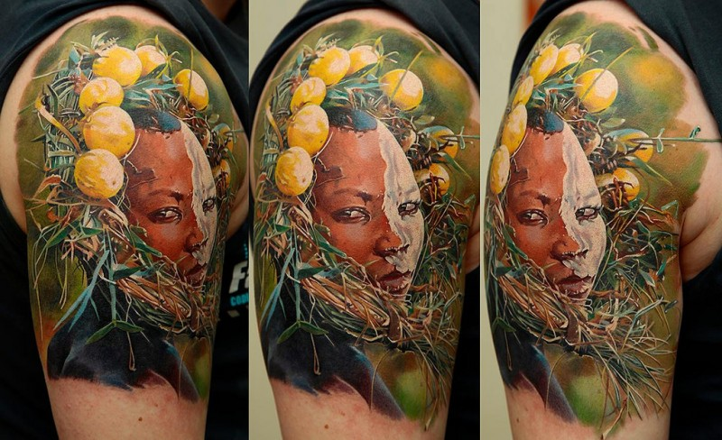 Illustrative style colored shoulder tattoo on tribe woman