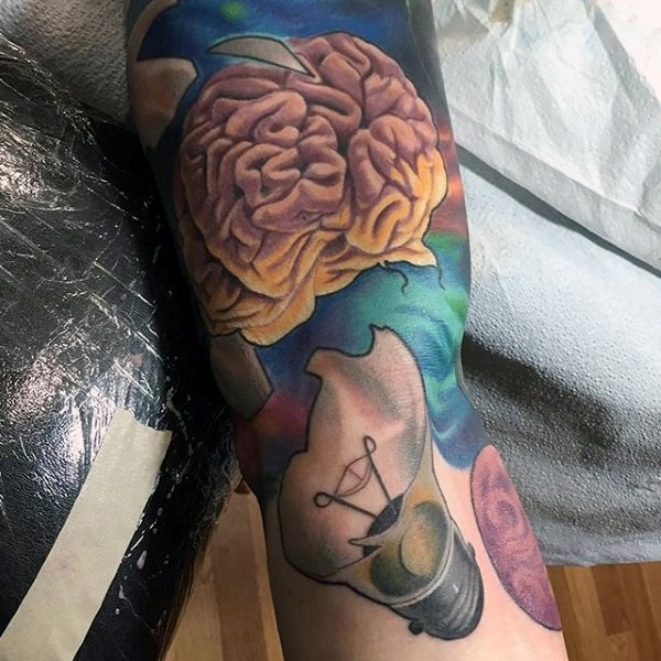 Illustrative style colored sleeve tattoo of human brain with broken bulb