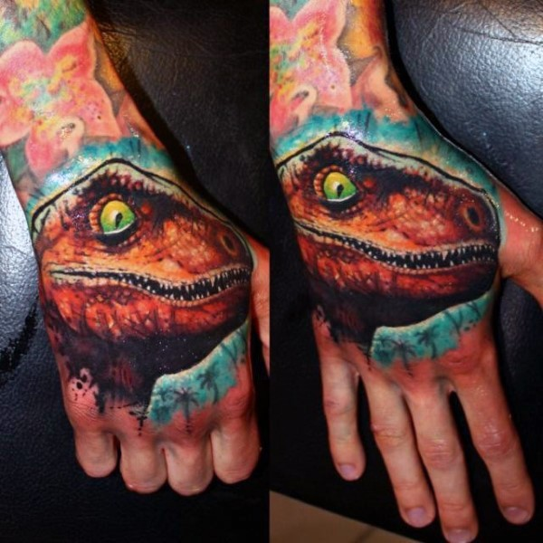 Illustrative style colored small dinosaur head tattoo on hand