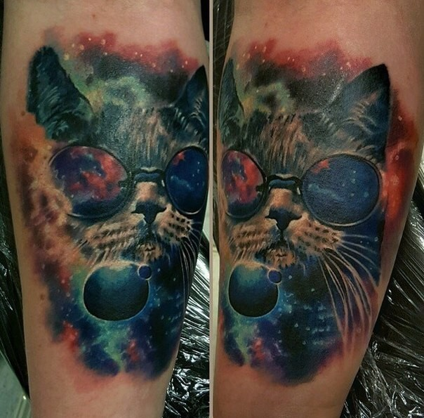Illustrative style colored tattoo of cat with space and planets