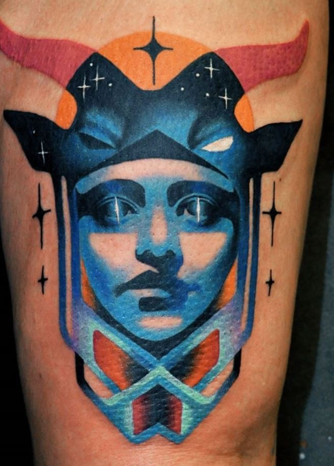 Illustrative style colored tattoo of fantasy woman face combined with animal helmet