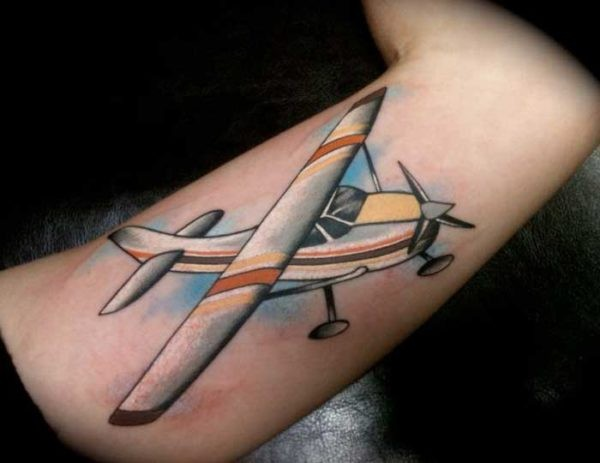 Illustrative style colored tattoo of large plane