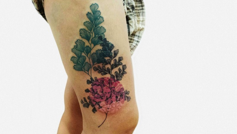 Illustrative style colored thigh tattoo beautiful plants