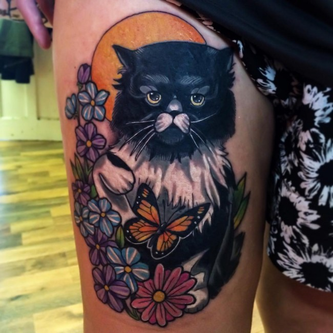 Illustrative style colored thigh tattoo of cat with flowers and butterfly