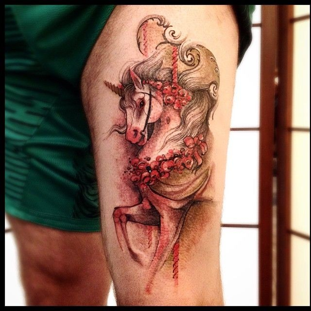 Illustrative style colored thigh tattoo of beautiful unicorn