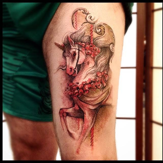 Illustrative style colored thigh tattoo of beautiful unicorn with flowers