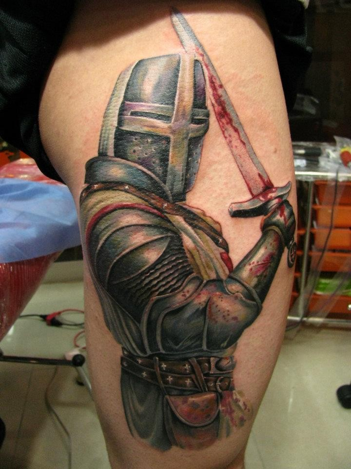 Illustrative style colored thigh tattoo of bloody medieval knight