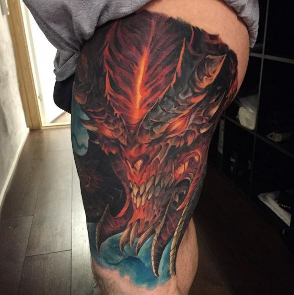 Illustrative style colored thigh tattoo of fantasy devil for Colorful thigh tattoos