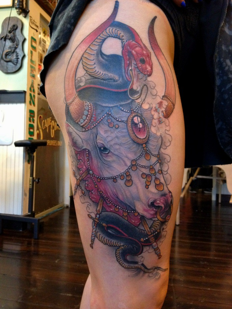Illustrative style colored thigh tattoo of saint bull with snake