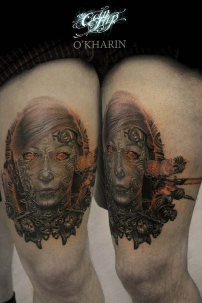 Illustrative style colored thigh tattoo of alien woman face with thigh