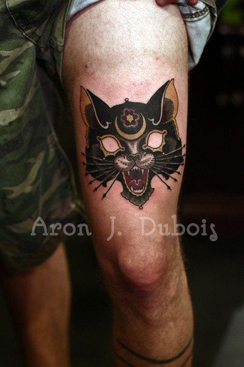 Illustrative style colored thigh tattoo of fantasy cat mask