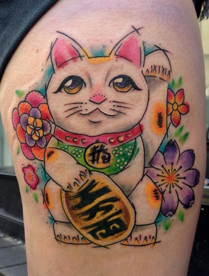 Illustrative style colored thigh tattoo of maneki neko japanese lucky cat with beautiful flower