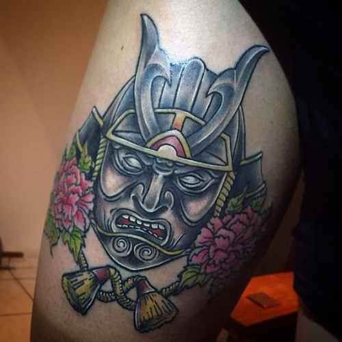 Illustrative style colored thigh tattoo of samurai mask and flowers