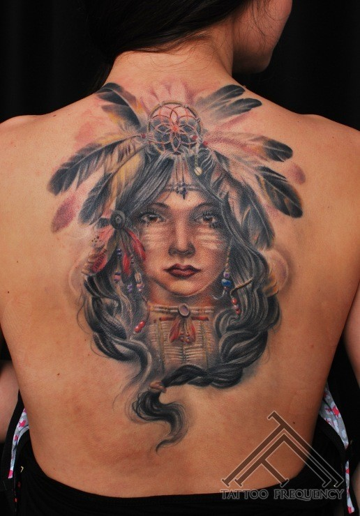 Illustrative style colored upper back tattoo of Indian woman portrait