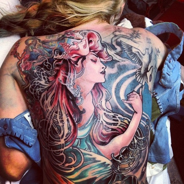 Illustrative style colored whole back tattoo of woman with pigeon