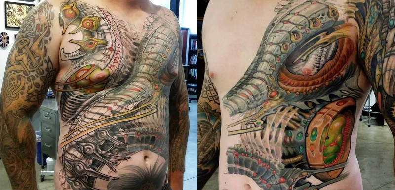 Illustrative style colored whole body tattoo of various ornaments
