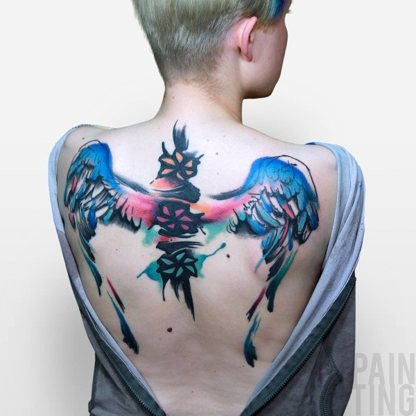 Illustrative style colored wings with symbols tattoo on back