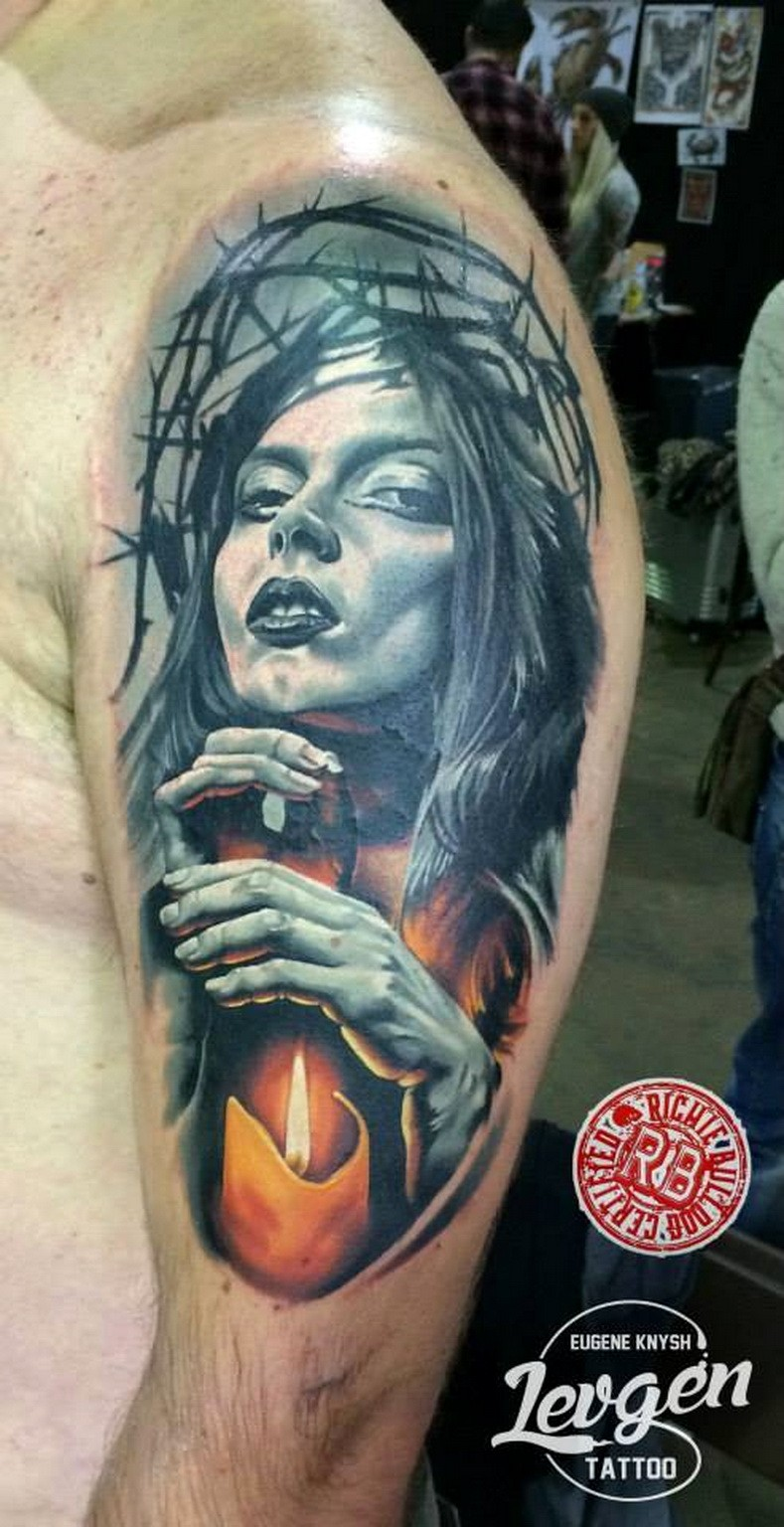 Illustrative style colored woman portrait tattoo on shoulder with candle
