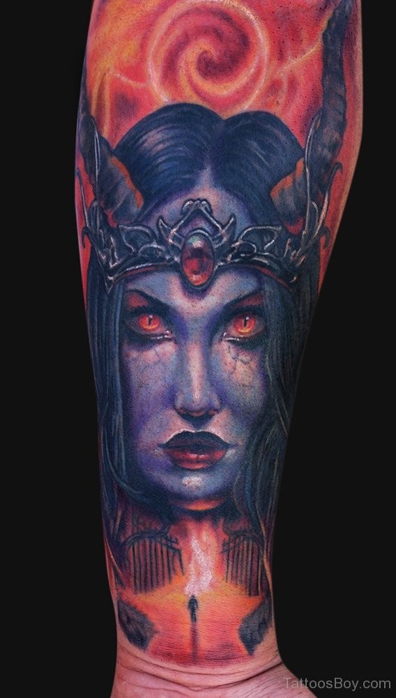 Illustrative style colorful forearm tattoo of demonic woman portrait