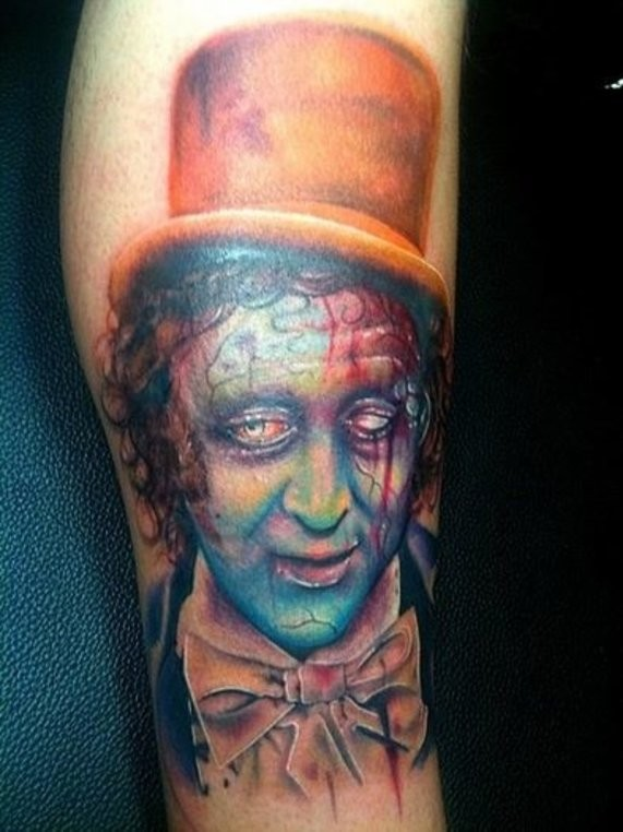 Illustrative style creepy looking leg tattoo of zombie clown in hat