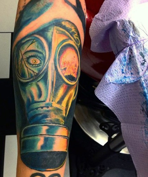 Illustrative style large colored forearm tattoo of creepy woman in gas mask