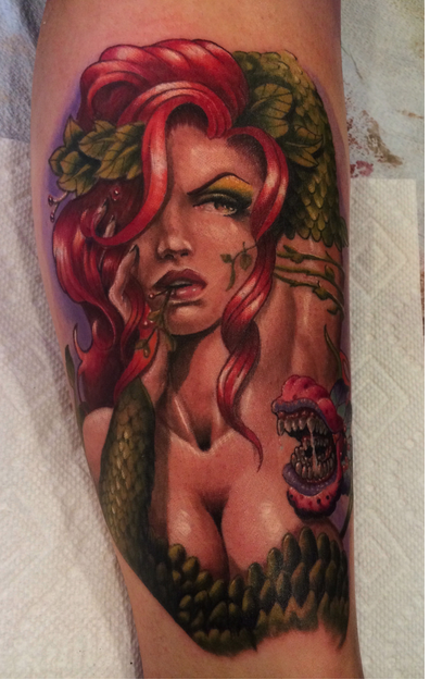 Illustrative style seductive looking colored leg tattoo of sexy Nature woman