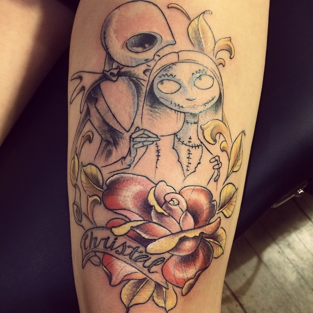 Illustrative style thigh tattoo of Nightmare before Christmas couple with flower and lettering